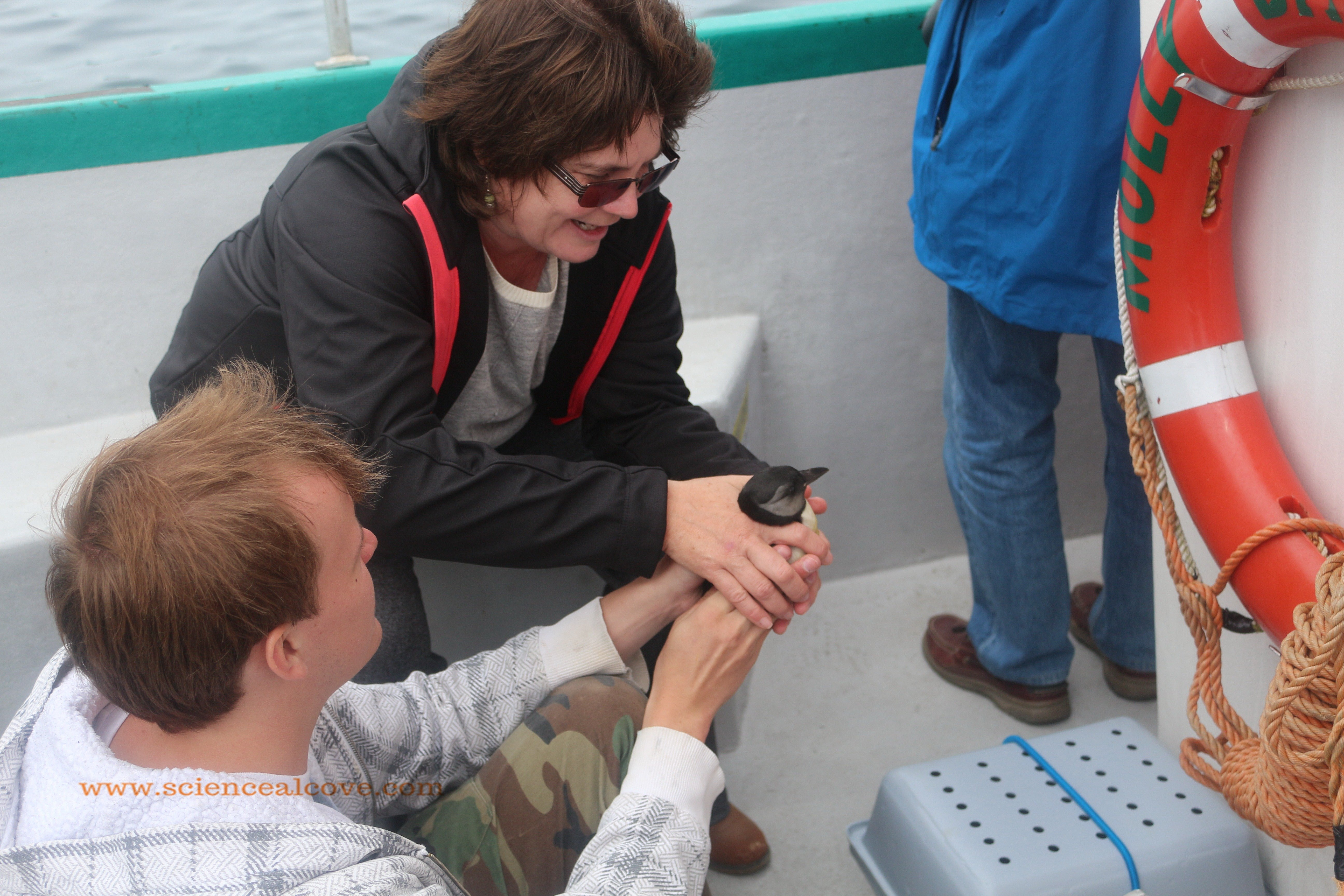 Meeting a baby puffling!  Look at that smile on my face.